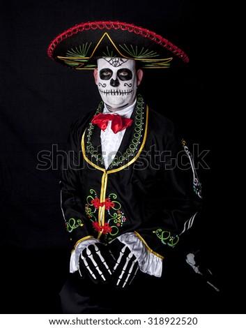 Man sitting in Cinco de Mayo halloween costume - stock photo