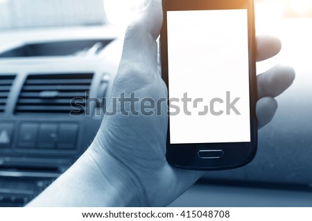 Man sitting in the car and holding a touch phone with isolated screen. - stock photo