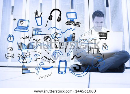 Man sitting next to different sketches with charts and different icons - stock photo