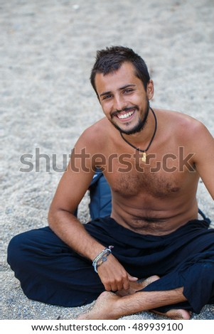 Man sitting on a beach