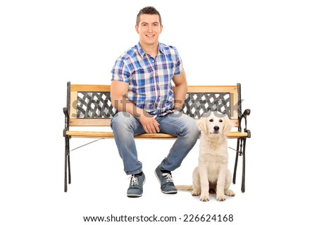 Man sitting on a bench with a cute puppy isolated on white background