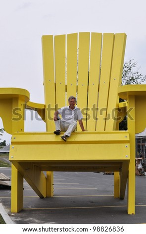 Man sitting on a giant chair