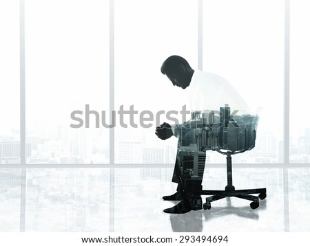 man sitting on chair in office, double exposure - stock photo