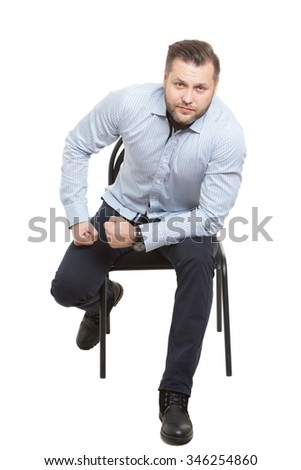 man sitting on chair. Isolated white background. Body language. gesture of readiness for action. starting position - stock photo