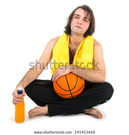 Man sitting on floor with basketball and orange juice, isolated at white background