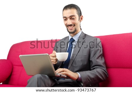 Man sitting on the sofa - stock photo