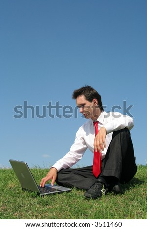 Man sitting outdoors using laptop