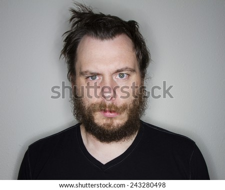 Man sitting there not interested  with whats going on - stock photo