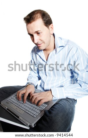 Man sitting using a laptop or notebook isolated on white - stock photo