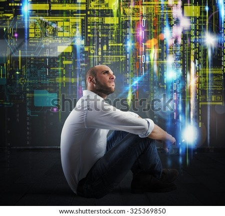 Man sitting with background of binary codes - stock photo