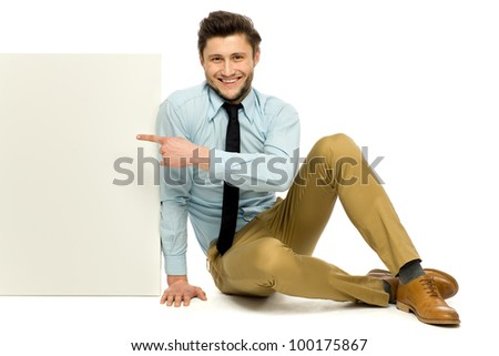 Man sitting with blank poster