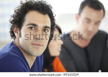Man sitting with his peers
