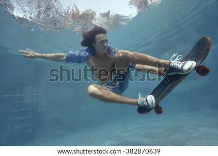 man skateboarding underwater swimming pool stock photo 382870639 shutterstock