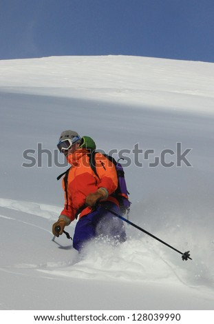 Man skiing fresh powder snow in the Utah backcountry, USA. - stock photo