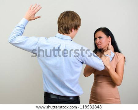 Man slapping a woman depicting domestic violence - stock photo