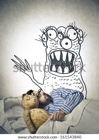 man sleeping dreaming a monster - stock photo