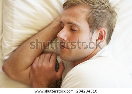 Man Sleeping In Bed - stock photo