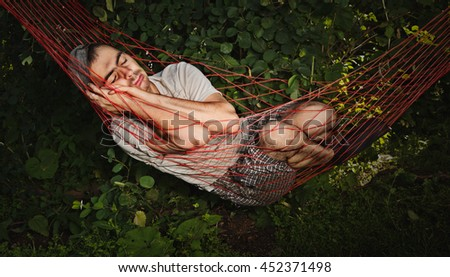 Man sleeping in hammock.