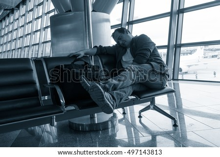 Man sleeping in the airport in a hall
