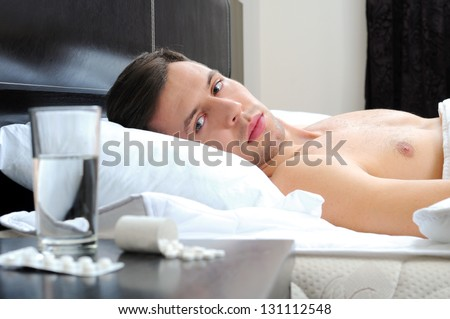 Man sleeping - pills on bed table