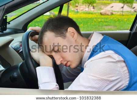 Man sleeps in a car. - stock photo