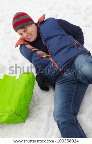 Man Slipped And Injured Back On Icy Street - stock photo