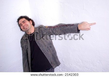 Man smiling giving the finger - stock photo