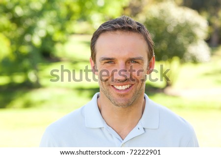 Man smiling in the park - stock photo
