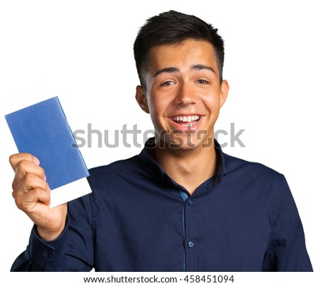 Man smiling, looking at camera and holding tickets with passport