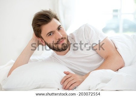 Man smiling on white bad