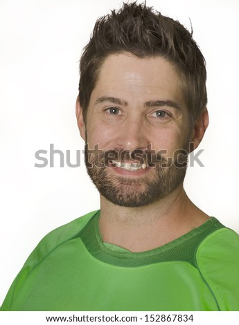 Man smiling wearing green soccer football athletic sport top, coach, sport picture. - stock photo