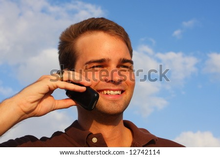 Man Smiling while on a Cell Phone