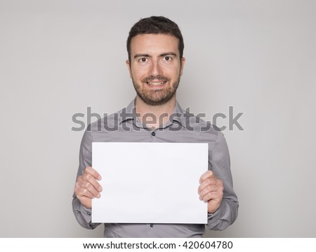 man smiling with a banner in his hands - stock photo