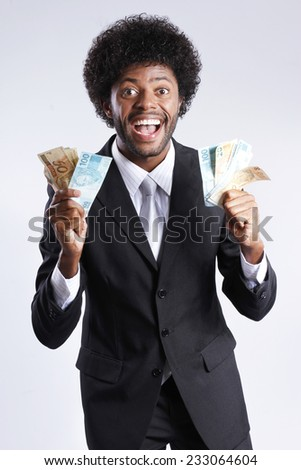 man smiling with money brazilian