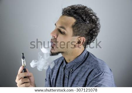Man smoke e-cigarette - stock photo
