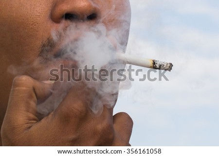 man smoking a cigarette close up