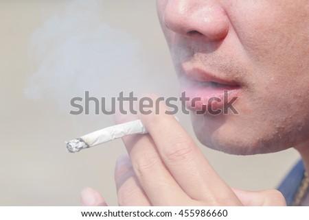 Man smoking cigarette - stock photo