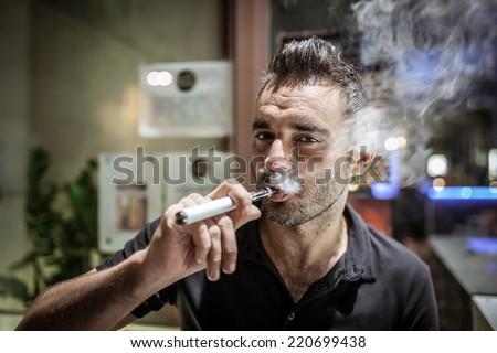 man smoking e-cigarette - stock photo