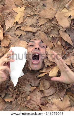 man sneezing in an autumnal concept - stock photo