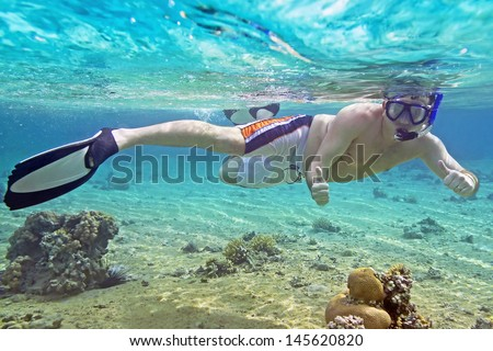 Man snorkeling in Red Sea of Egypt