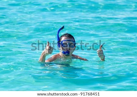 Man snorkeling in the Caribbean Sea - stock photo