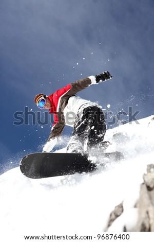 Man snowboarding - stock photo