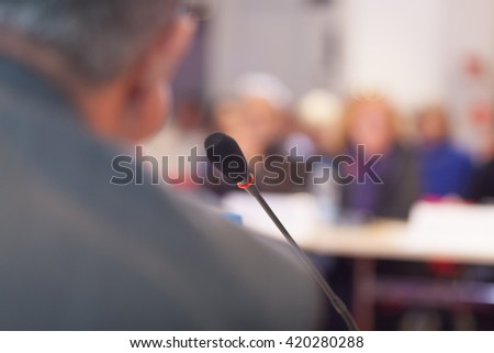 man speaking at the business meeting