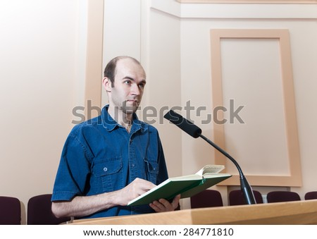 Man speaks on the conference - stock photo
