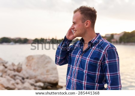Man spending time on seashore and using phone
