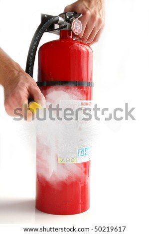 man spraying a fire extinguisher, on white - stock photo