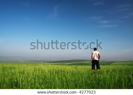 man stand on green field