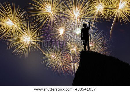 man stand on the top of cliff with celebration firework.