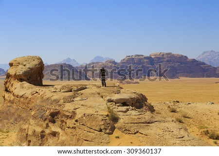 Man standing alone in the desert