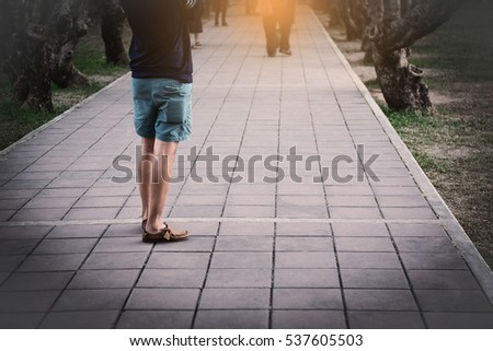 Man standing alone with space road